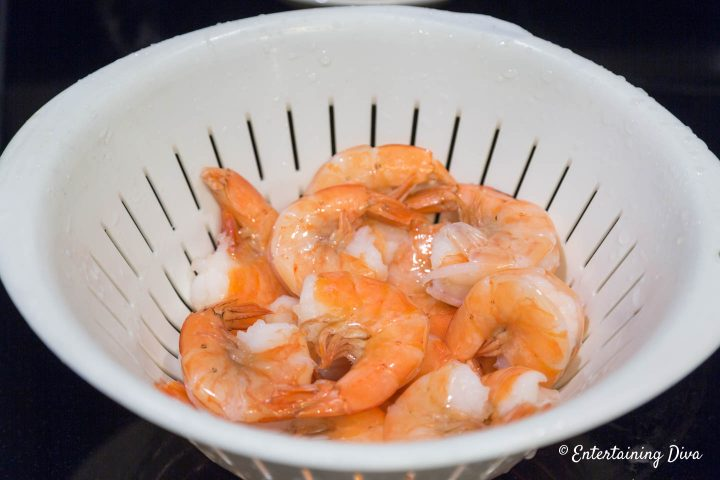 Shell-on shrimp in a colander