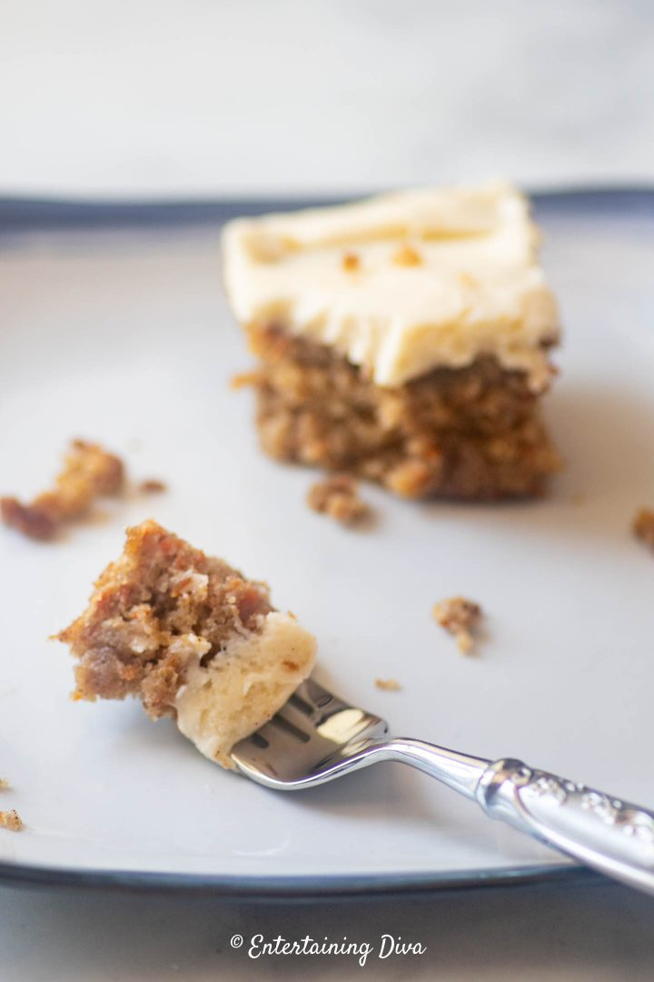 A piece of classic carrot cake on a fork