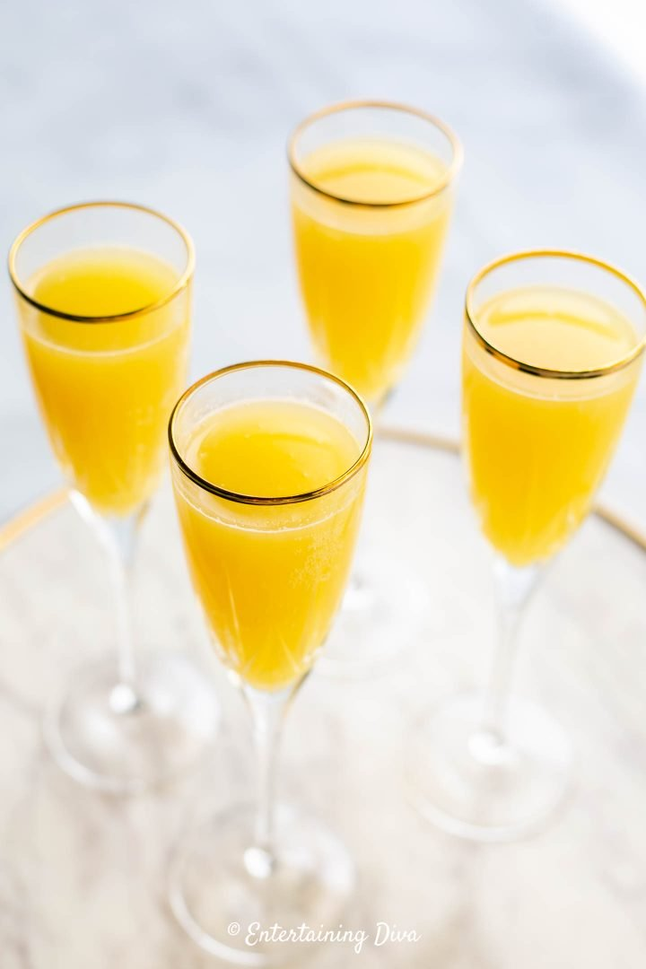 Classic mimosa recipe in champagne flute glasses
