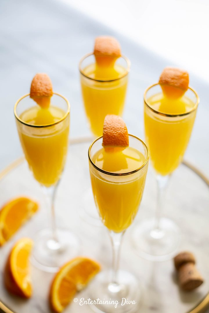 Mimosas with orange slices as garnish