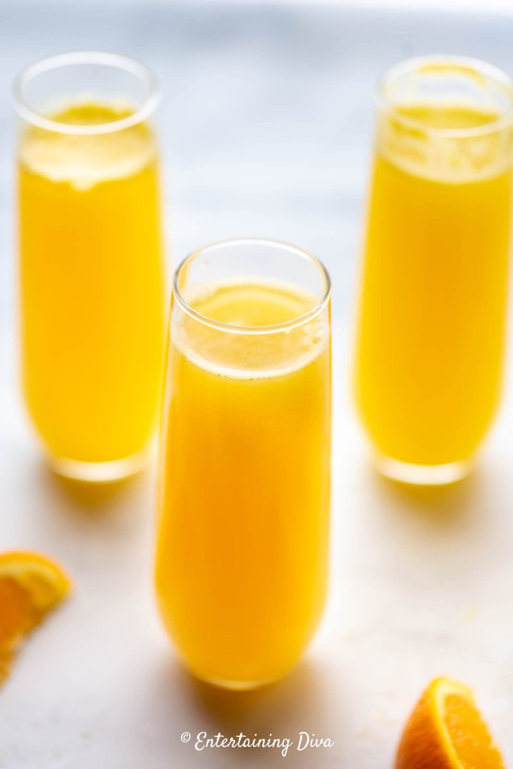 Classic mimosas in stemless flute glasses