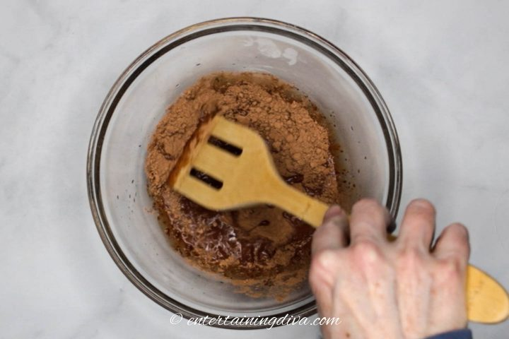 Cocoa powder being mixed with water
