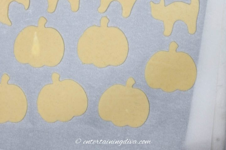 Pumpkin cut outs on a cookie sheet