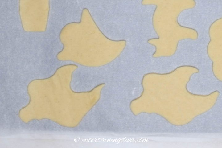ghost cookie cutouts on cookie sheet