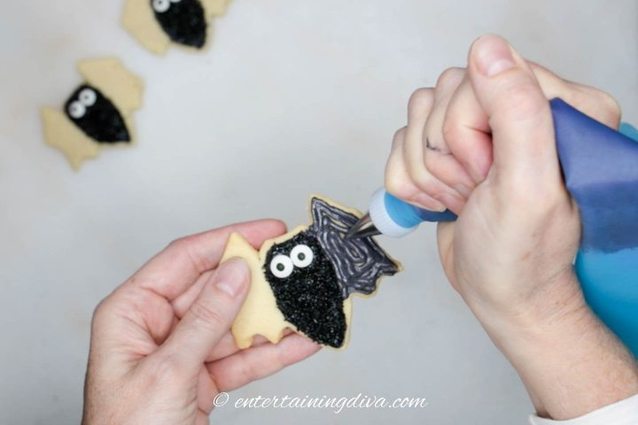 Bat wings being flooded with black royal icing