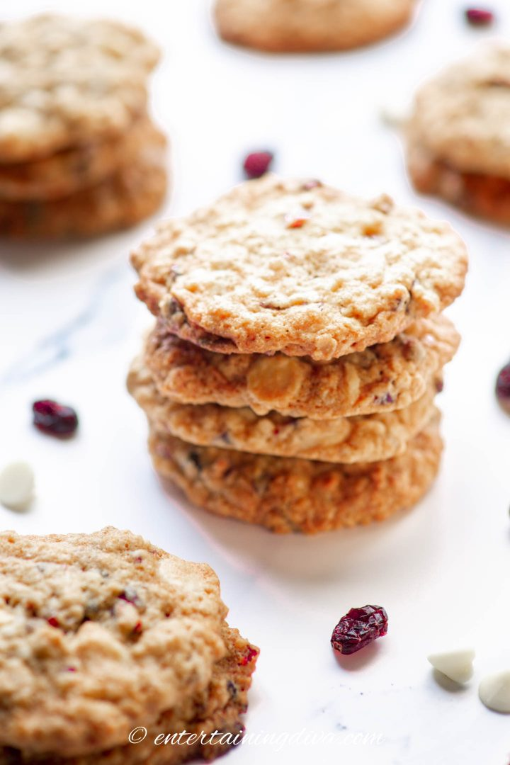 cranberry and white chocolate oatmeal cookies stacked on the counter
