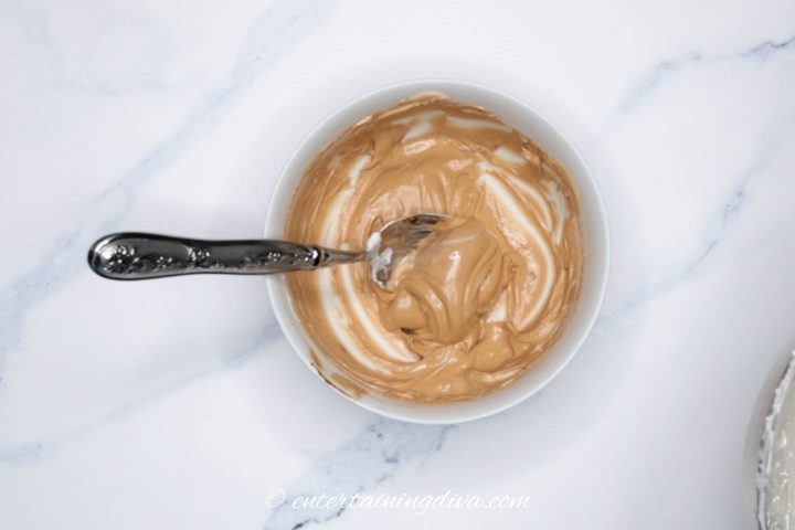 brown royal icing in a bowl