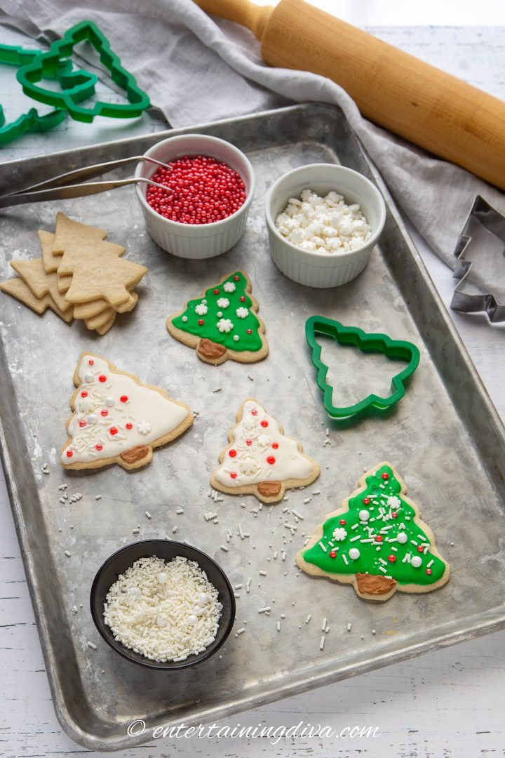 Christmas tree sugar cookies with cookie decorating supplies