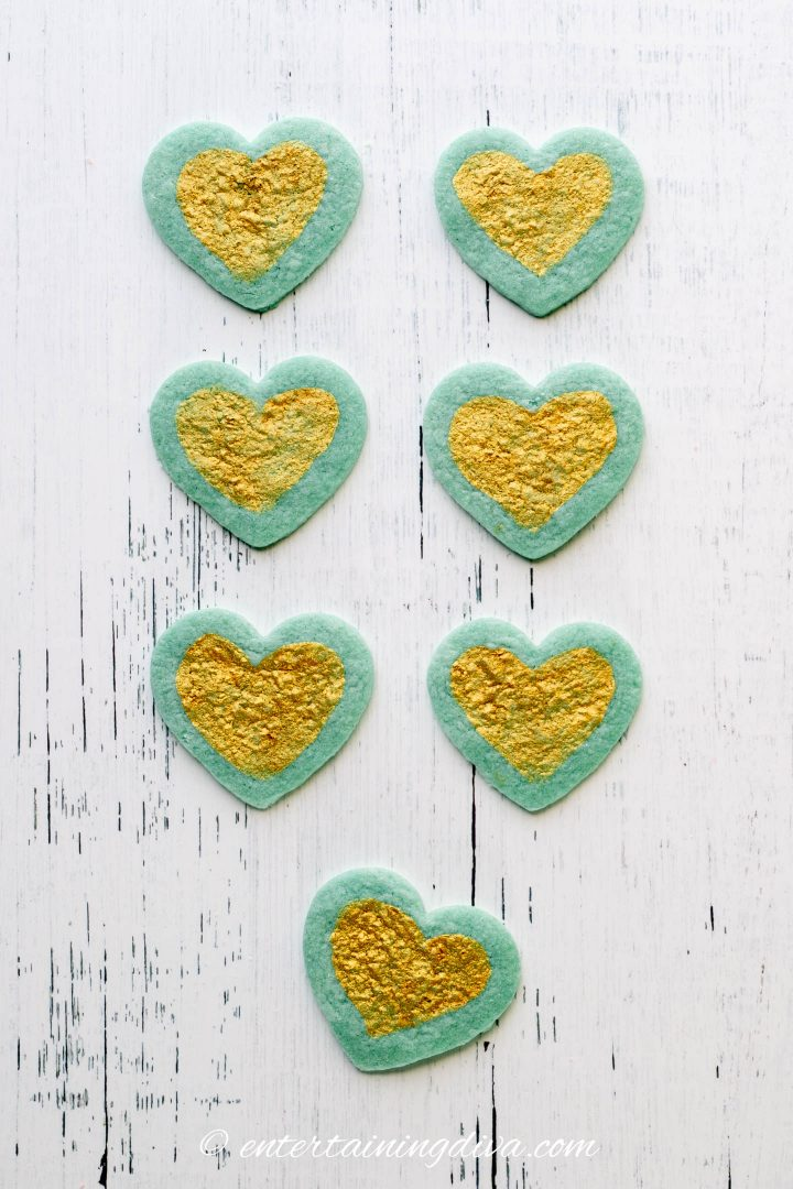 Blue heart sugar cookies decorated with gold edible paint