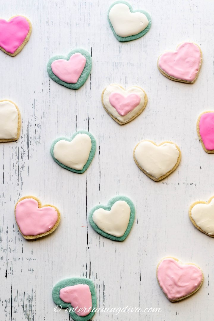 Heart cookies made with blue and white cookie dough, frosted with white and pink royal icing