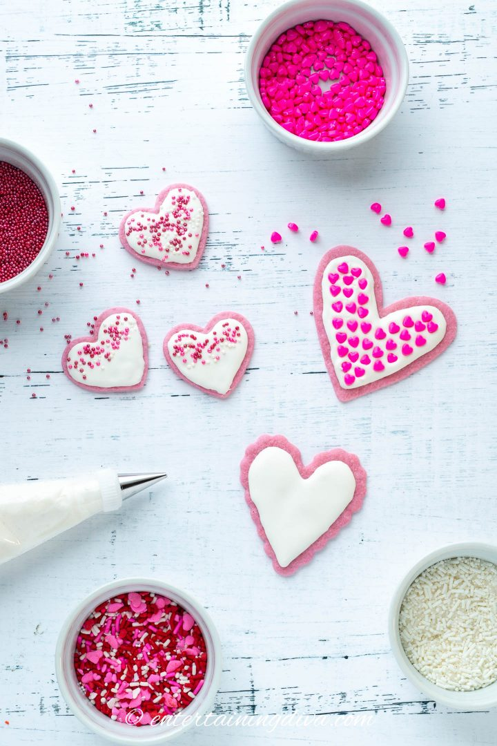 Valentine's Day Heart cookies with royal icing and various pink, red and white sprinkles
