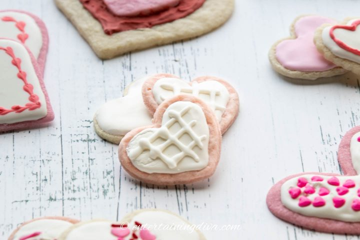 Heart cookies decorated with white royal icing and a criss-cross pattern