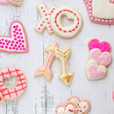Assorted Valentine sugar cookies decorated with pink, white, red and gold icing