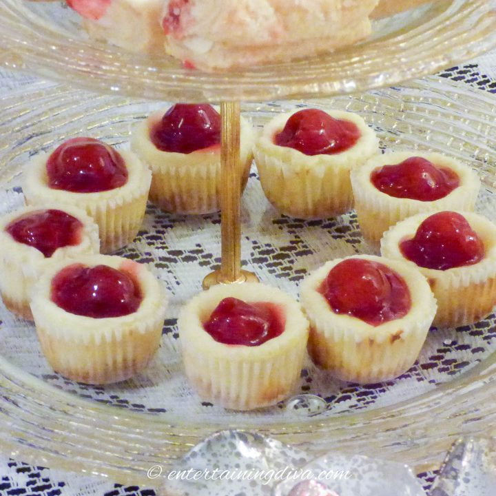 Cherry cheesecake cupcakes on a tray