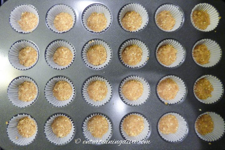 vanilla wafer crust in the bottom of baking cups
