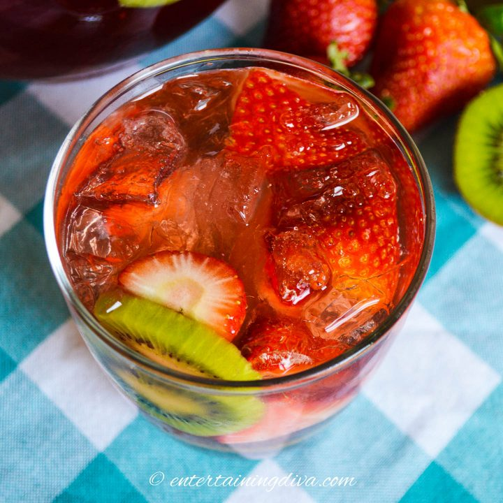 top view of strawberry kiwi sangria in a glass