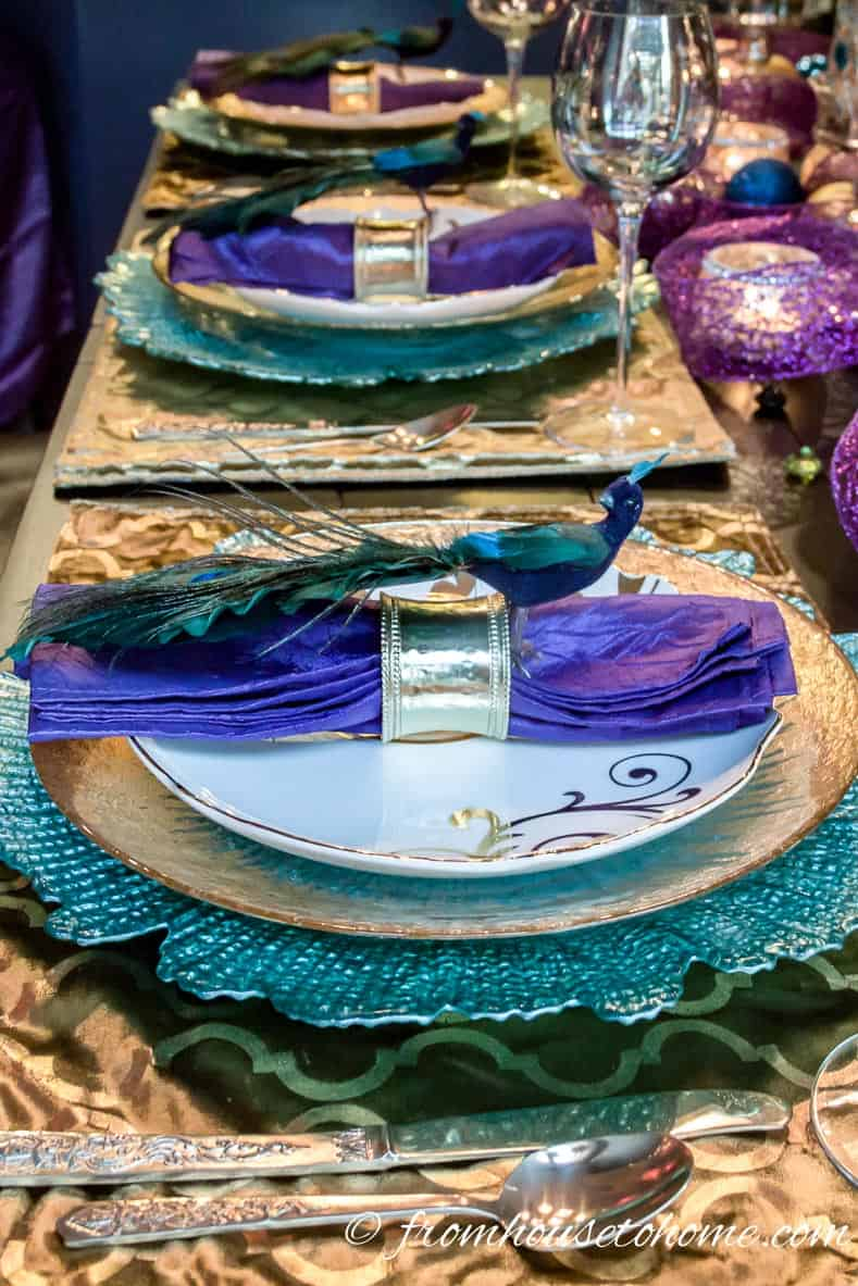 Peacock Christmas ornaments used as napkin rings on a table setting