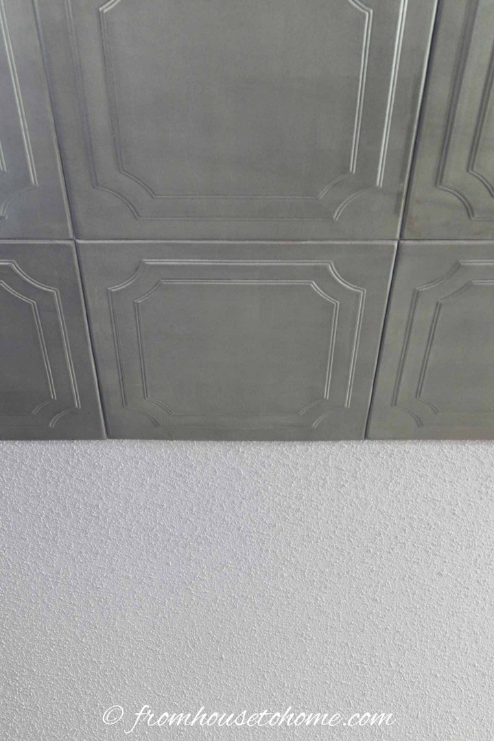Faux tin ceiling tiles on a popcorn ceiling