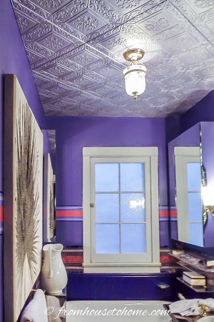 Purple bathroom with styrofoam faux tin ceiling tiles painted silver