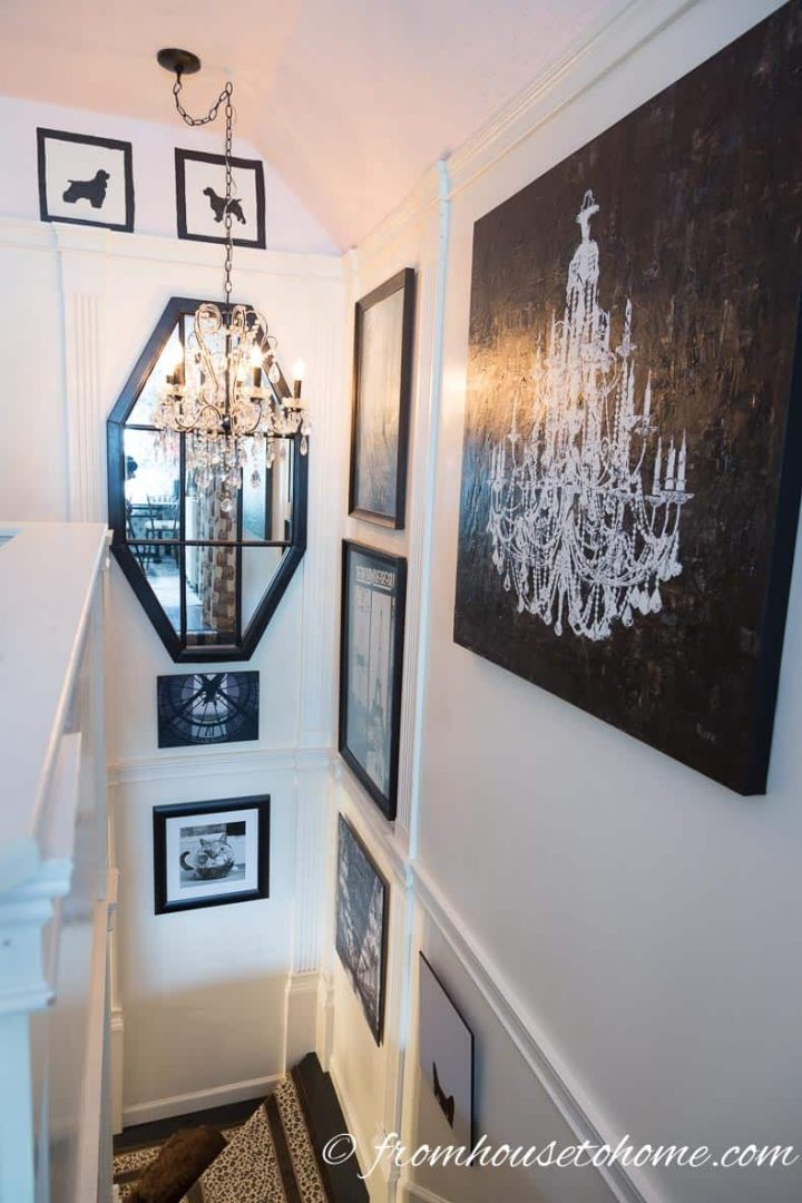 Faux columns and pictures hung in a white stairway