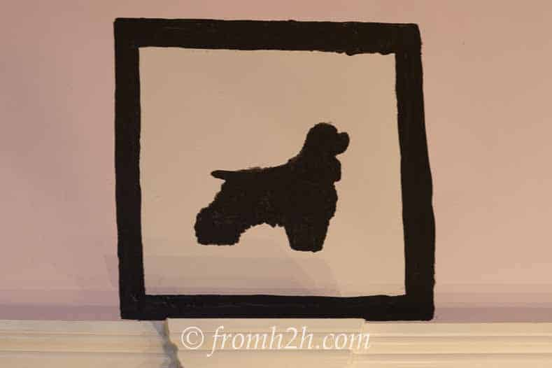 Silhouette dog and frame painted onto the wall