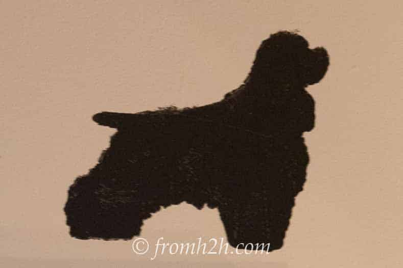 Silhouette dog painted onto a frame mat