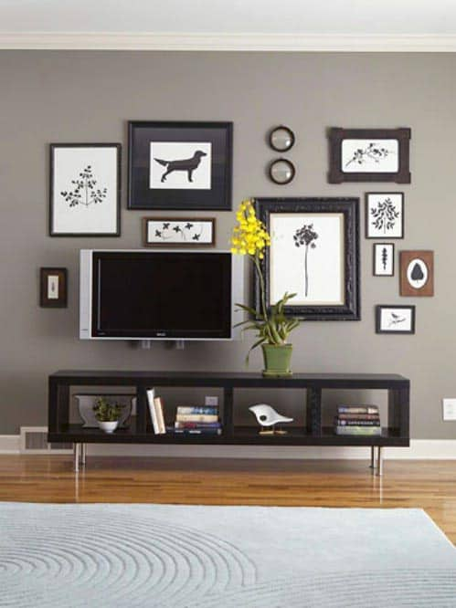 TV is disguised in an art wall from bhg.com