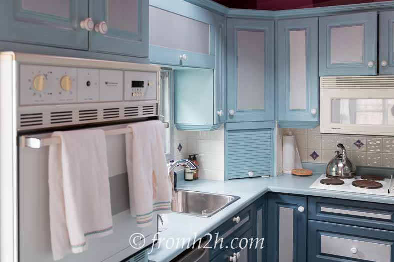 Make sure the doors are clean before painting   How to Paint Melamine Kitchen Cabinets