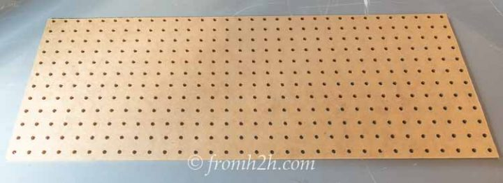 Peg board cut to fit inside the armoire doors