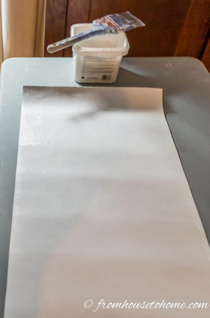 Wallpaper paste was brushed onto the back of the wallpaper