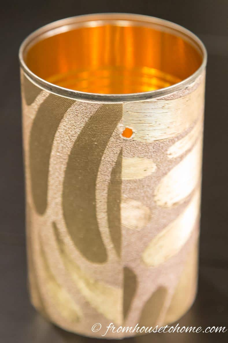 Wallpapered Aluminum Can With Hole Drilled just below the rim