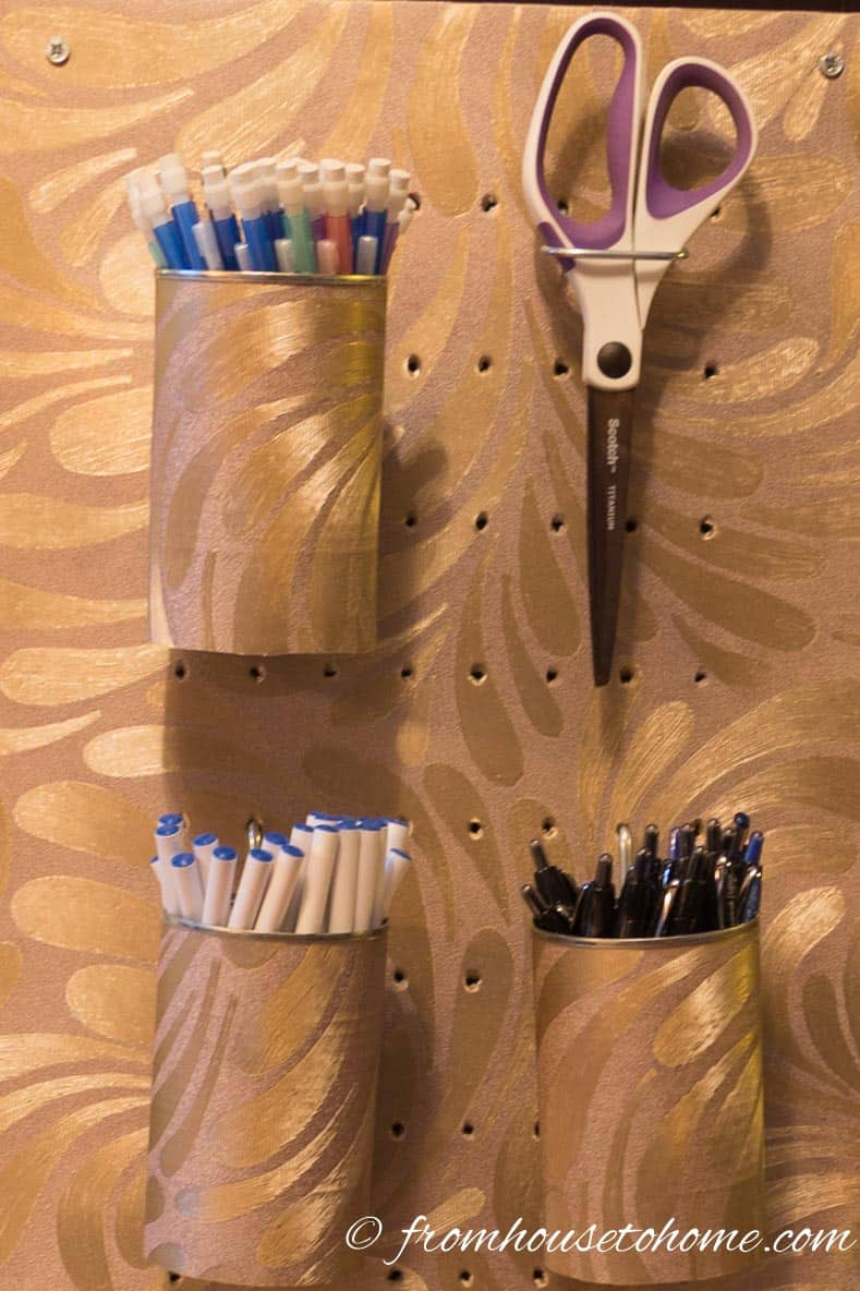 Wallpapered Aluminum Cans Make Great Pen Holders | 10 Easy Ways To Decorate With Wallpaper | If you're looking for some creative DIY wallpaper ideas or ways to use up some leftover bits, this list of easy ways to decorate with wallpaper is perfect!