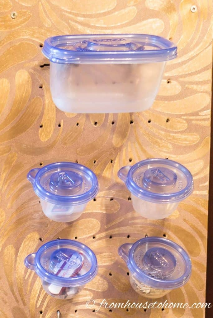 Plastic containers used as pegboard accessories