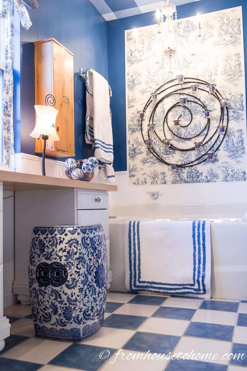 Add a blue and white garden stool | How to Beautify a Boring Builder Grade Bathroom