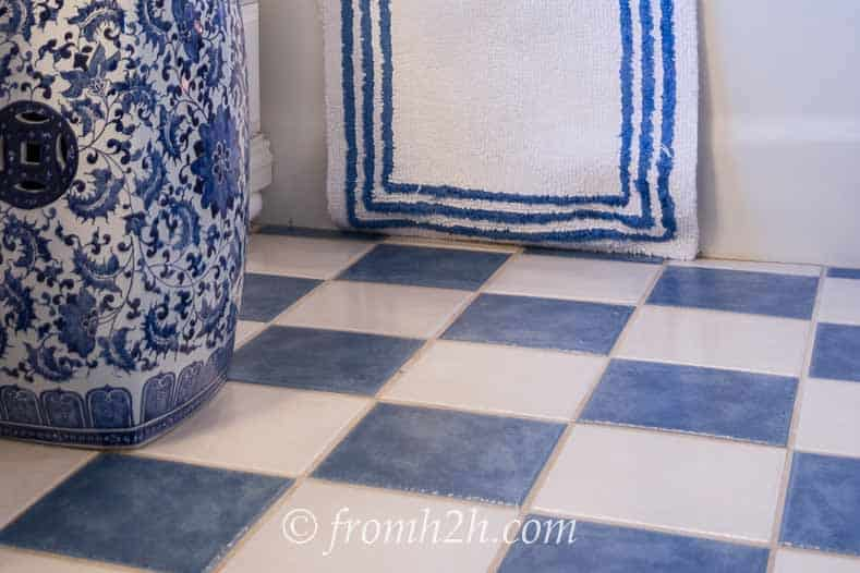 Blue and white ceramic tile floor | How To Beautify a Boring Builder Grade Bathroom