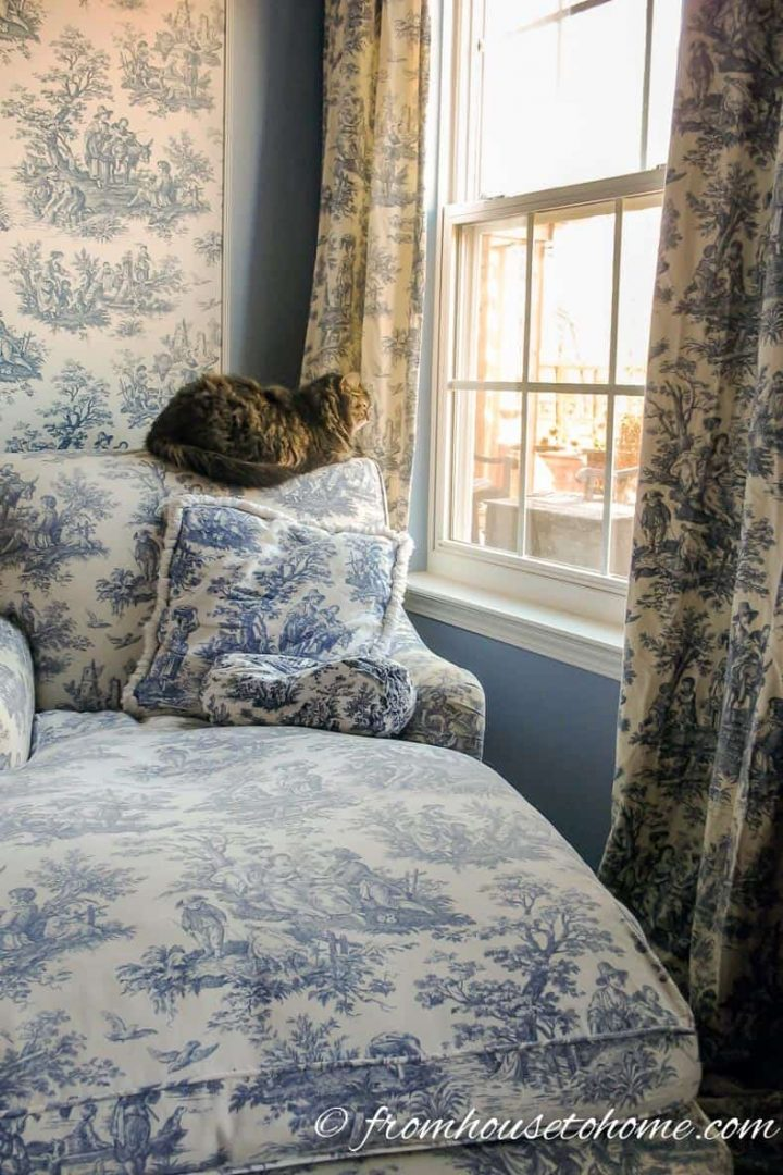 Blue and white chaise in a bedroom with down-filled cushions