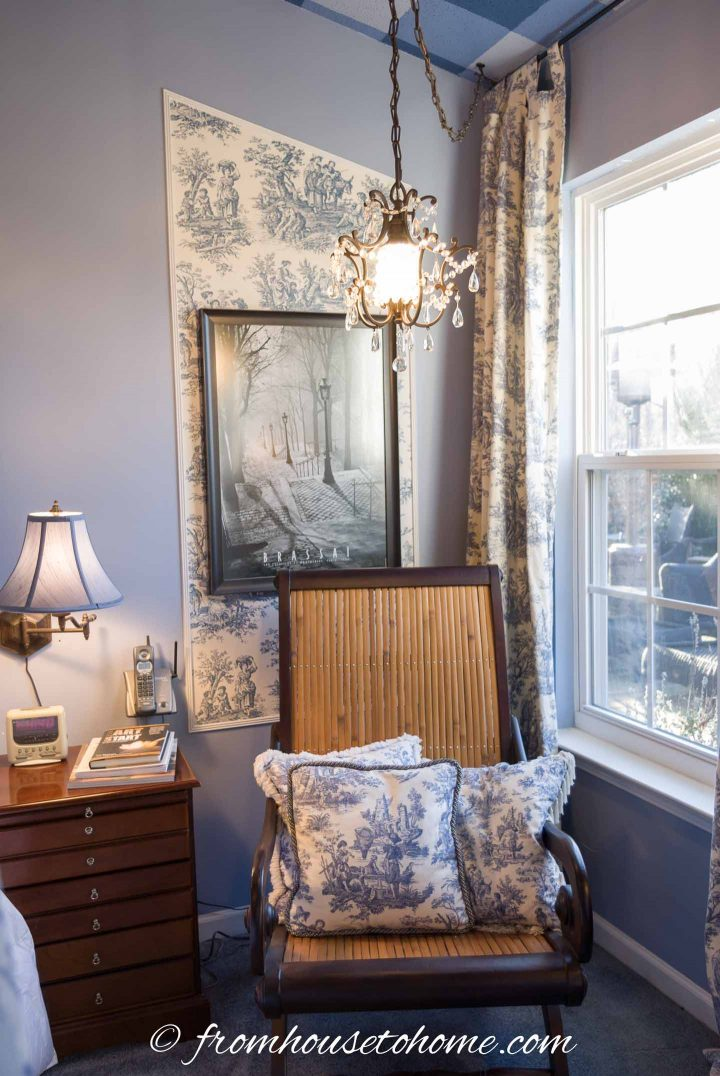 A picture of Paris and mini chandelier in a blue and white toile bedroom