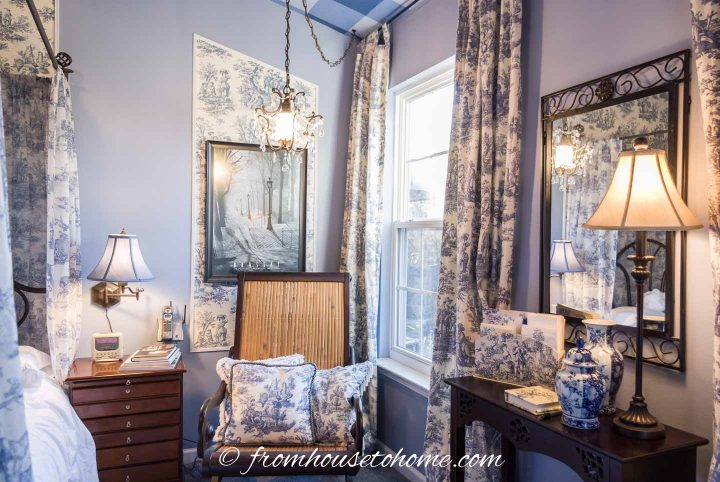 Blue and white toile curtains in a blue bedroom
