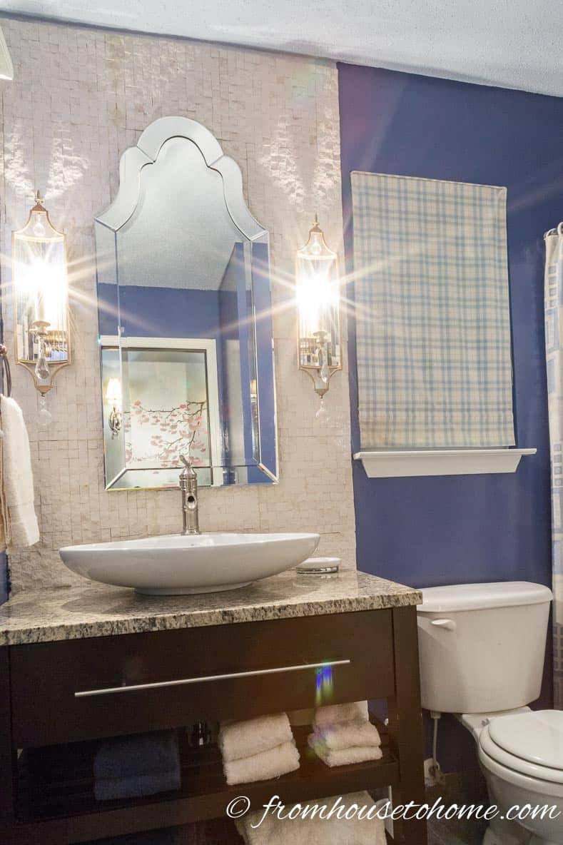 The accent wall provides a focal point behind the vanity