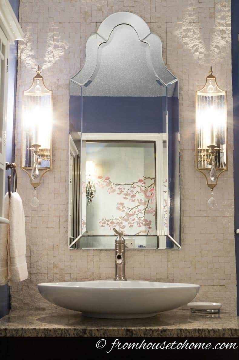 Using a Venetian mirror over the sink adds some glam to this bathroom | How to Renovate a Small Bathroom on a Budget