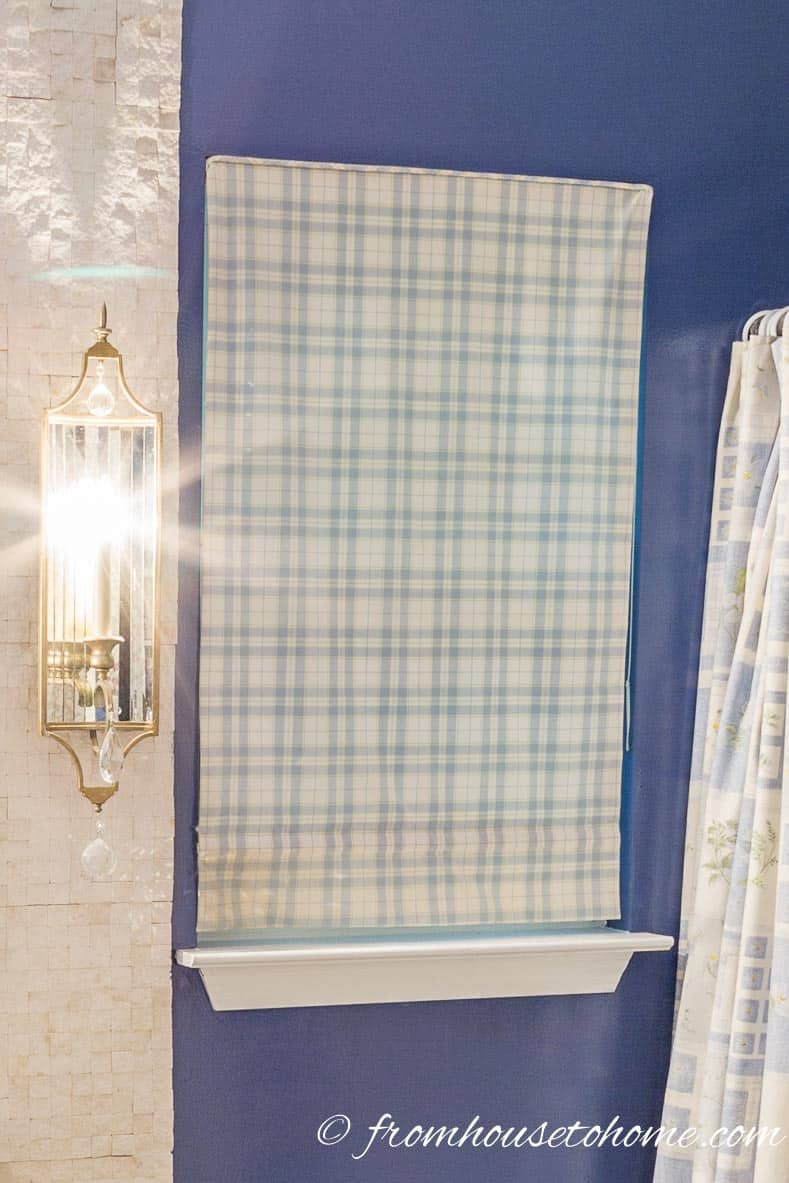 Simple roman shade as the bathroom window treatment | How to Renovate a Small Bathroom on a Budget