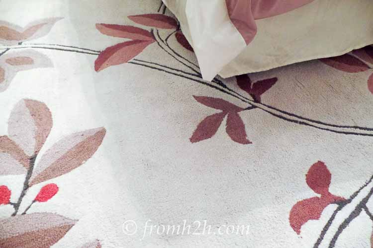 The new light grey area rug | From Eclectic To Serene Bedroom Makeover