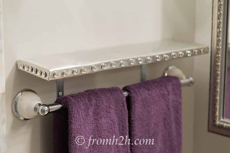 Silver shelf with not so straight nail head trim | How To Install Nail Head Trim In a Straight Line With Even Spacing