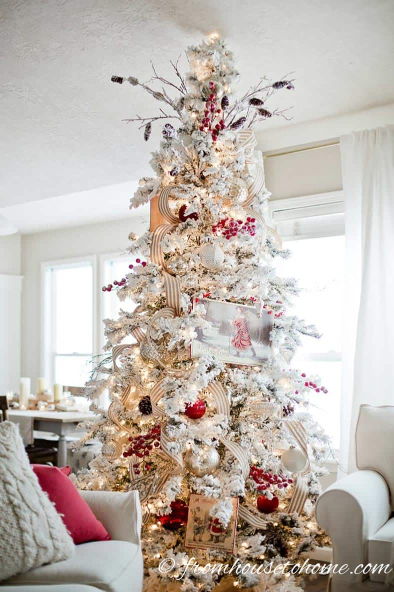 White and gold Christmas tree with red accents from ellaclaireinspired.com | How To Decorate a Beautiful Christmas Tree