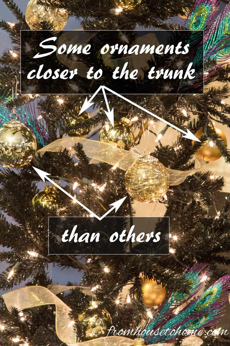 Add ball ornaments with some closer to the trunk than others | How To Decorate a Beautiful Christmas Tree