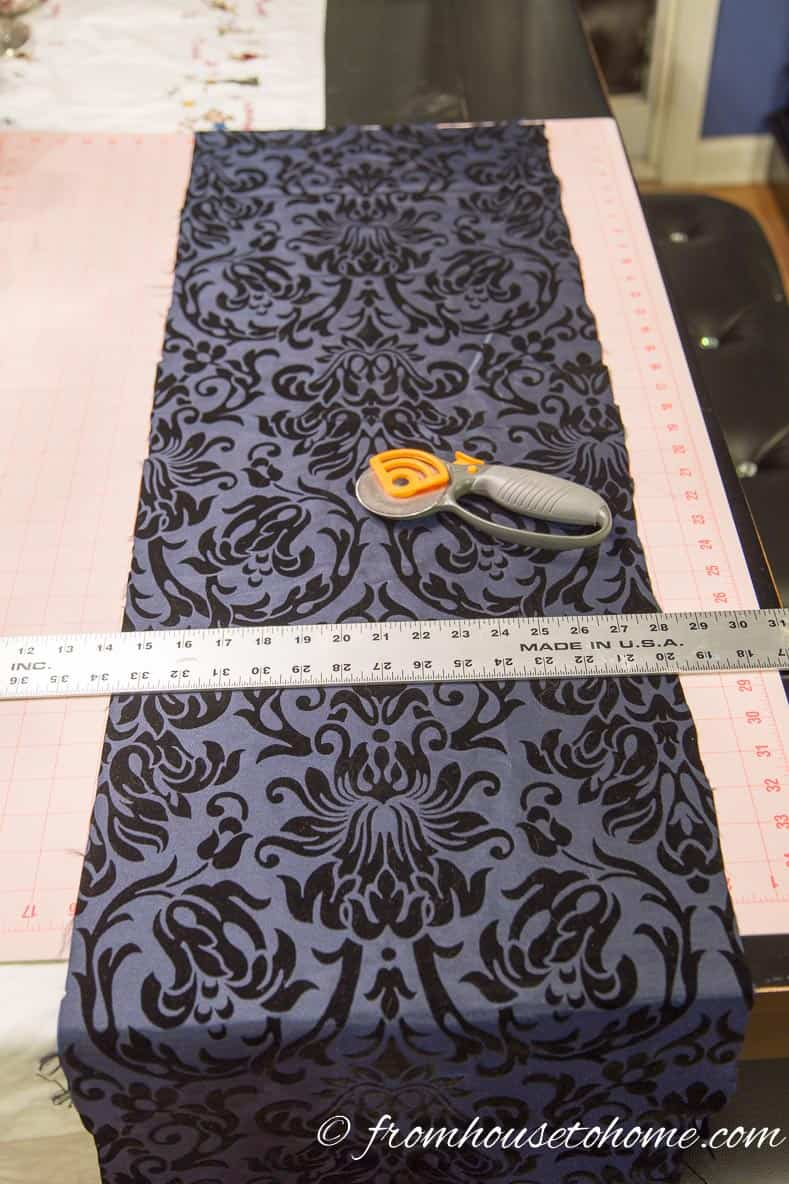 Cut the fabric to a size slightly larger than the panels