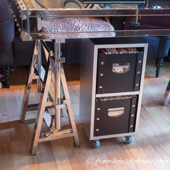 Silver and black industrial style filing cabinet under a silver desk
