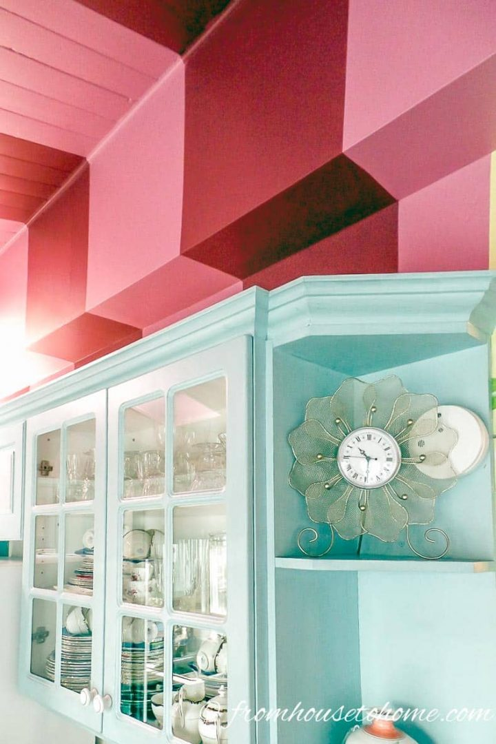 Wall and ceiling painted with pink stripes
