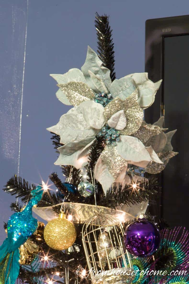 The poinsettia tree topper | How To Decorate a Beautiful Christmas Tree