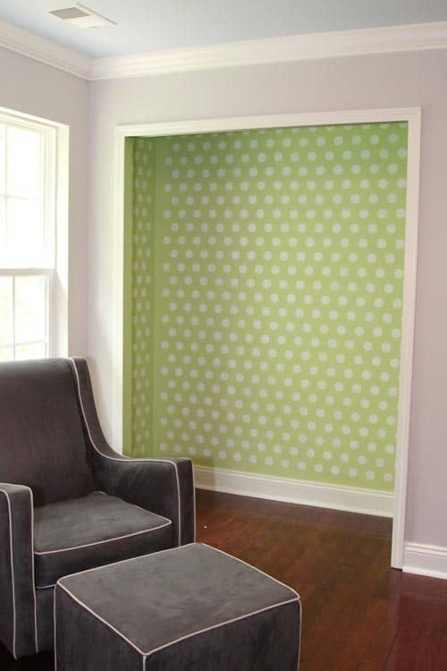 Stenciled polka dots on a closet wall from thelilhousethatcould.com